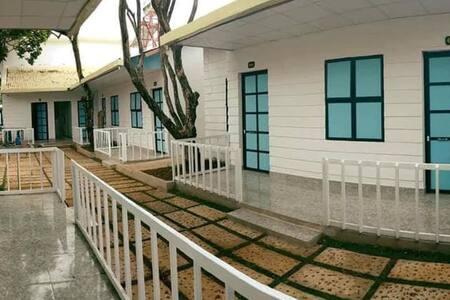 Hani House garden with balcony .