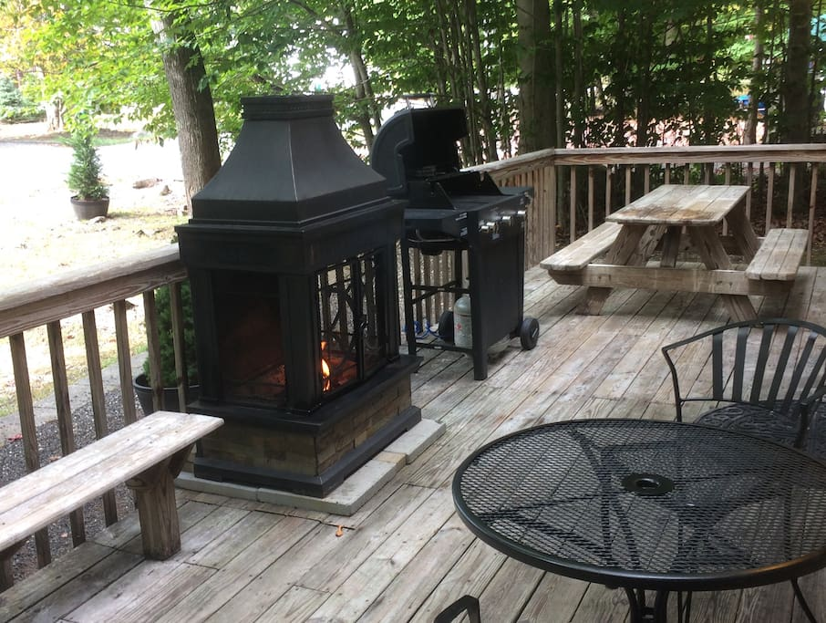 Deck w/ patio furniture, outdoor fireplace and gas grill