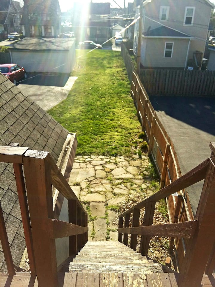 Large backyard with private patio where guests can enjoy a bonfire off the private entrance. Supplies included!