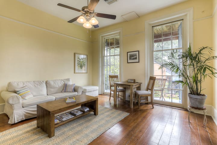 Relax in the sunny third-floor-apartment living room, under 10-foot ceilings