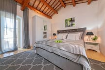 First Bedroom with a private spacious terrace & Smart TV