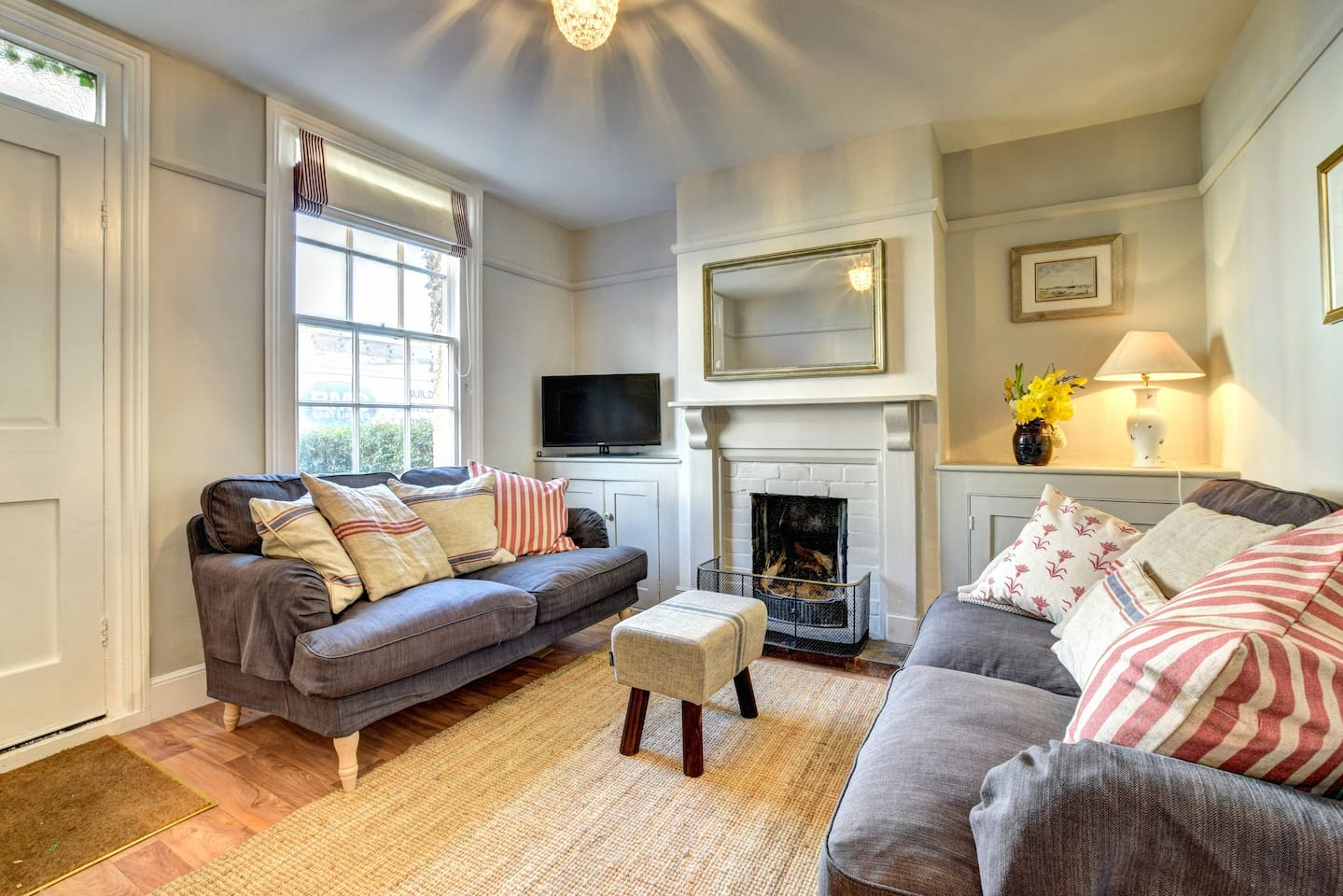 Spacious and light sitting room with cosy fire