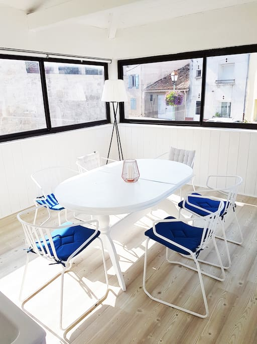 Sunny dining room with beautiful view on the town square