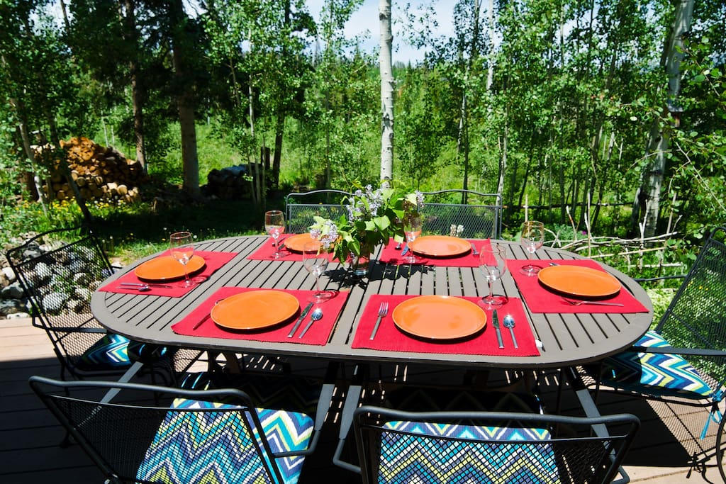 Enjoy an alfresco meal and forest views on the deck.