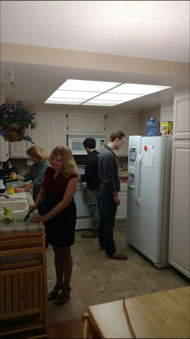 Happy community living in kitchen (permission from people to use photos).