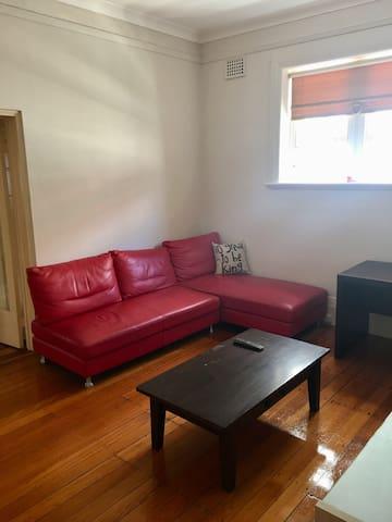 Lounge with desk, TV, ceiling fan