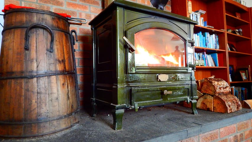 Cruachan Holiday Home | Scottish Highlands | Enjoying the wood burning stove on a cold winter day