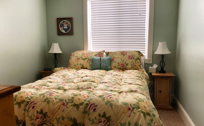 One of two bedrooms in the basement with a comfortable queen bed.