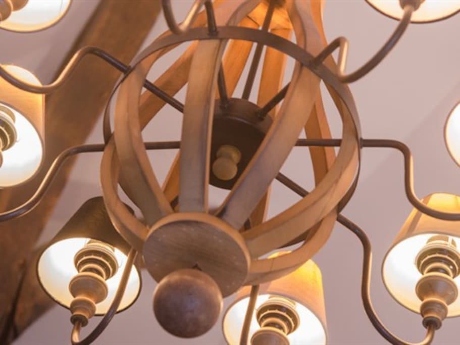 Stylish chandelier hanging from the vaulted ceiling.
