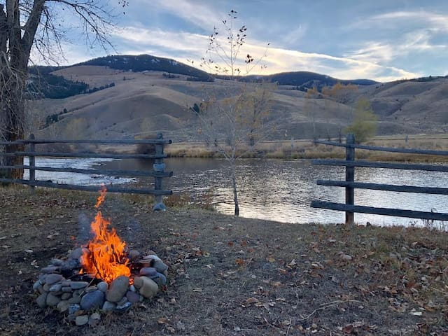 Relax around a fire with a glass of wine and incredible views