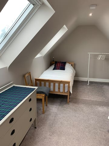 The twin bedroom has a single bed at either end