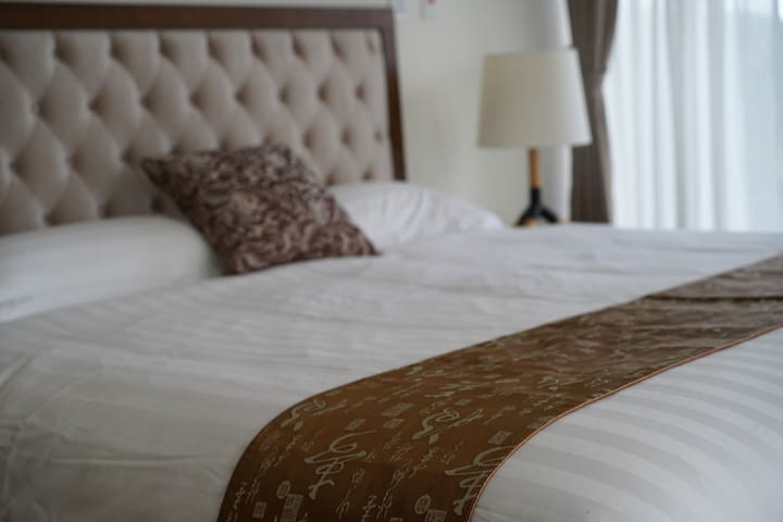 Our brand new Queen size bed is SUPER comfortable- new linens and high thread count sheets guarantee a great night's rest!