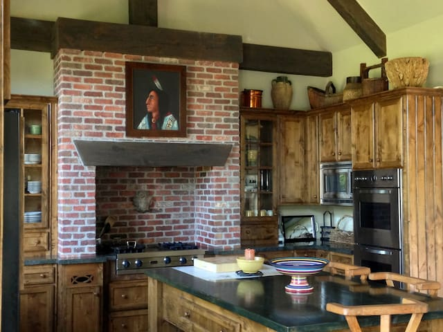 Gourmet Kitchen . large island Viking appliances. Double oven