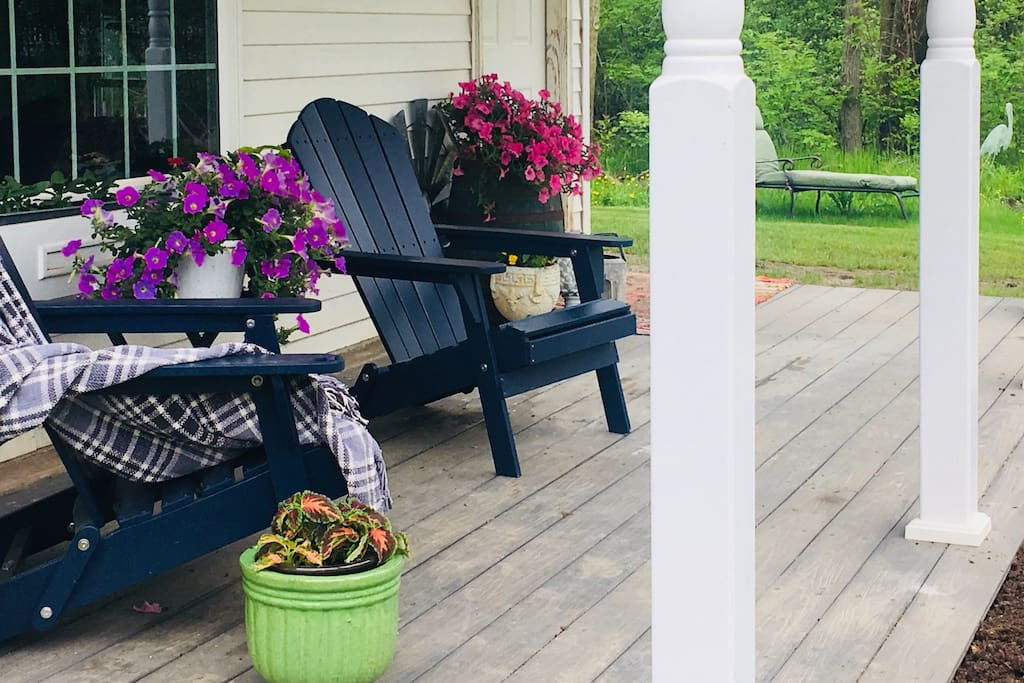 The spacious front porch, overlooking our pond and four-square garden is the perfect location to enjoy your morning coffee.