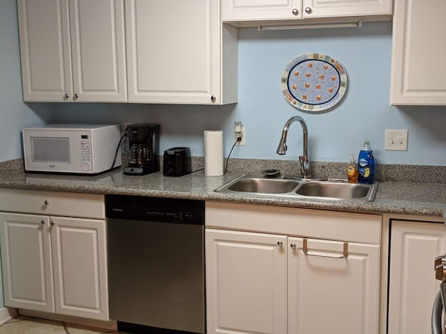 Fully stocked kitchen--fridge, dishwasher, stove, coffee pot, blender, toaster, microwave & full dishes and utensils for your entire group!