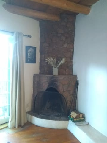 Large stone fireplace -- a rarity in New Mexico where small adobe fireplaces reign