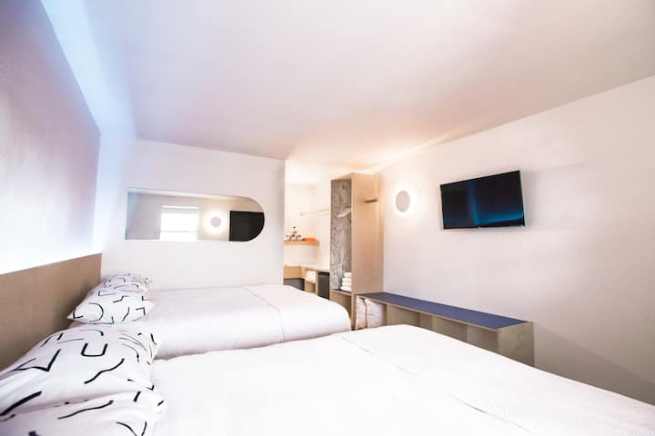 The Cozy Camellia Room at the Iris Motel