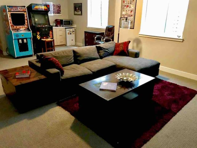 Super comfy sectional, stand up arcade games, and of course fridge, microwave and Keurig!