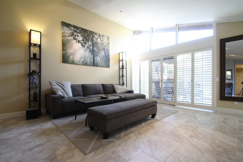 Over view LR  with Plantation shutters open to peaceful and beautiful backyard leading directly onto golf-course and just steps away from tennis courts and pools.