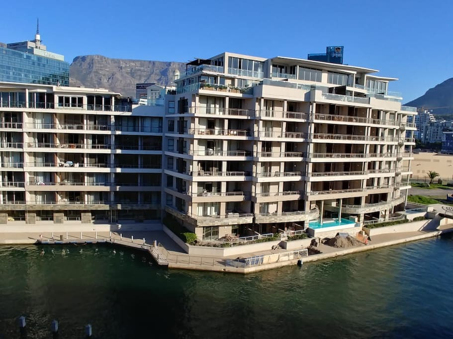The exterior of the Apartment block. Views of Table Mountain behind