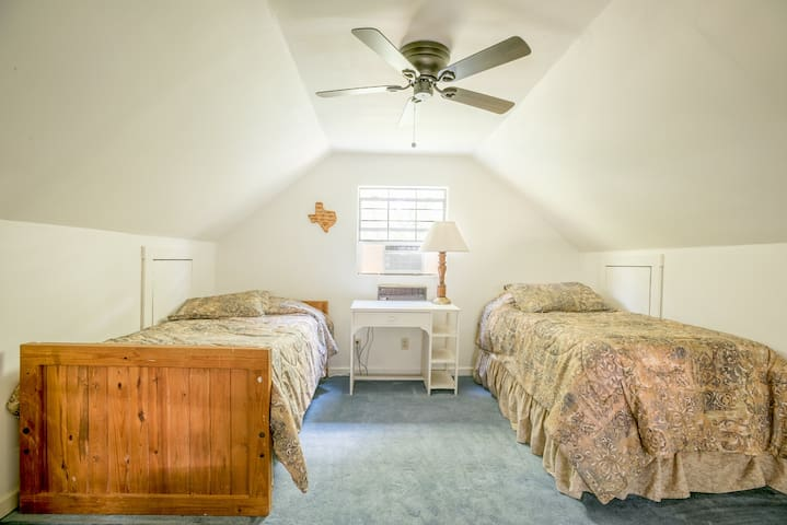 Two of four twin beds upstairs.
