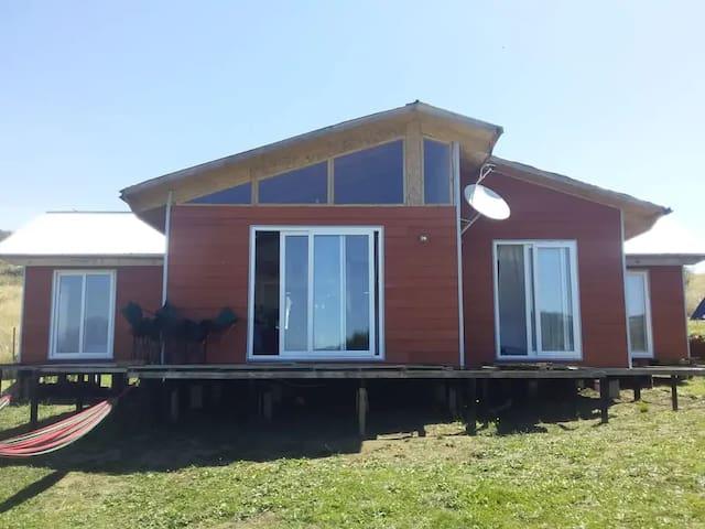 Alojamiento para grupos o familias frente al lago