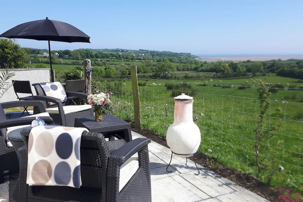 Patio area with views across Red Wharf Bay and Llanddona Beach