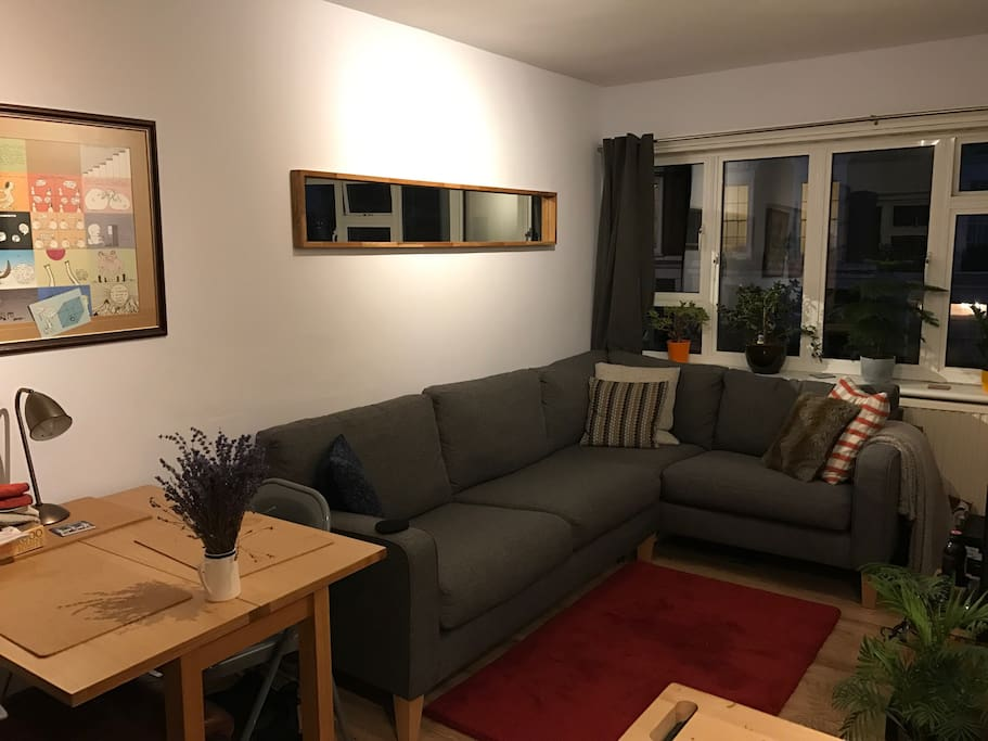 Bright, cosy, peaceful living area with new furniture, large comfortable sofa, TV, PlayStation, dining area and kitchenette.