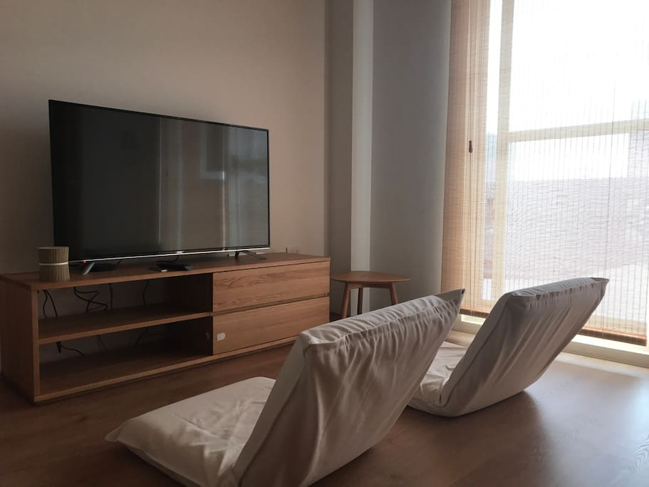Another room for guest. TV, Wifi, two Japanese chairs, one side table. Outside is a big terrace.