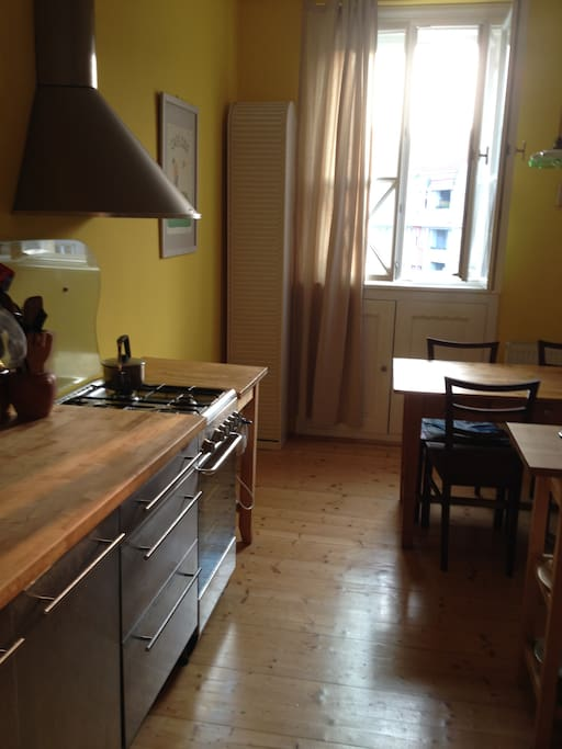 Fully equiped kitchen with table fo four and a little original food storage