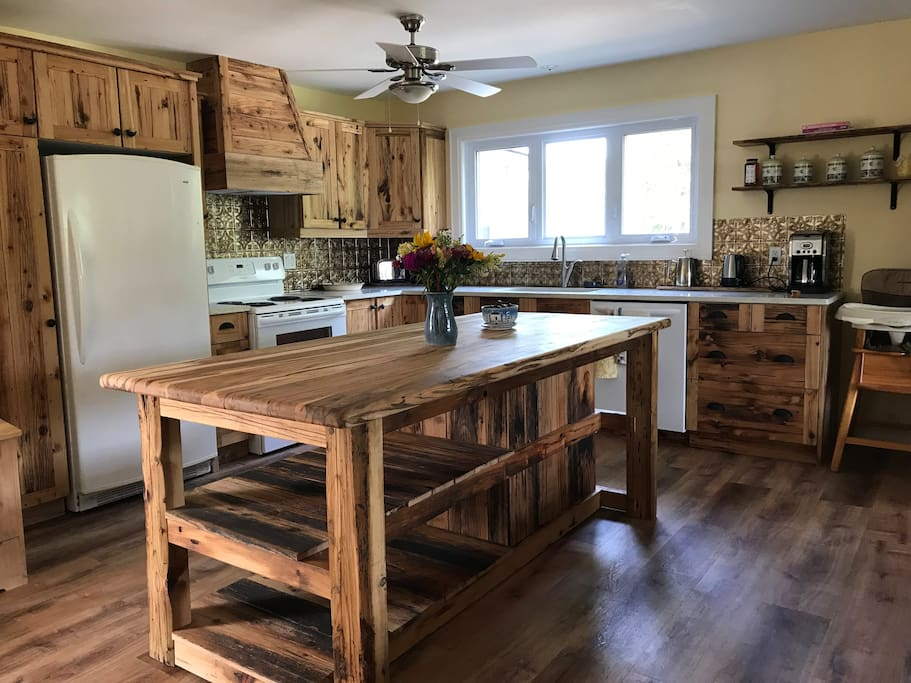 The completed kitchen island with reclaimed barn board from the land!