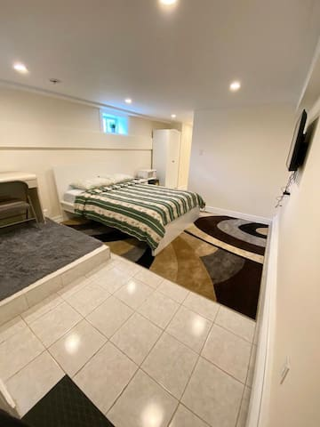 Spacious and Private bedroom with area rug.