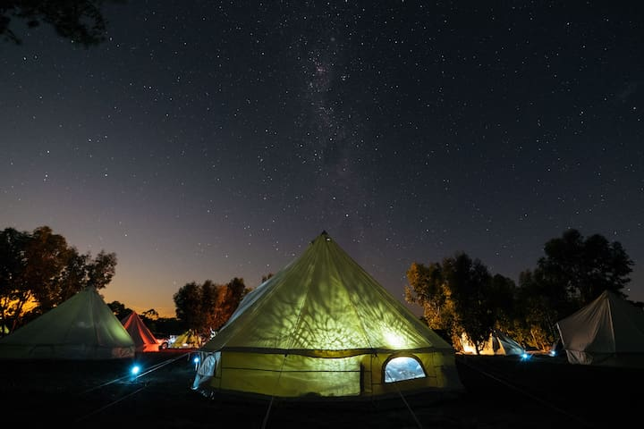 The Bell Tent at night, glamping under a starry sky