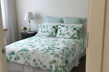 Beautiful linen on the bed.  Bedroom also has a desk & TV. Plenty of hanging space.