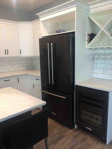 Fridge has ice and water built in, wine fridge