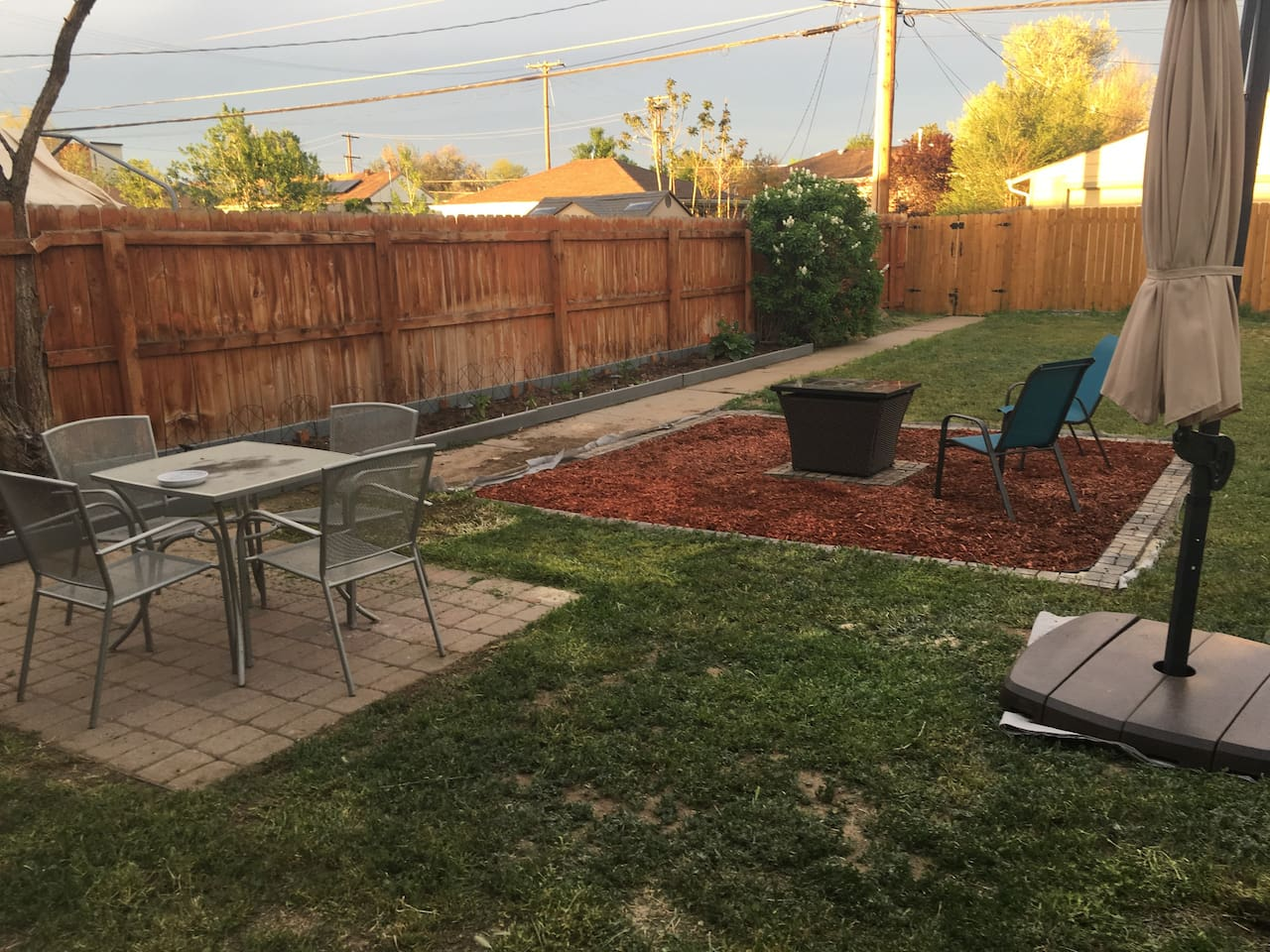 Garden patio, fire pit, and BBQ area.