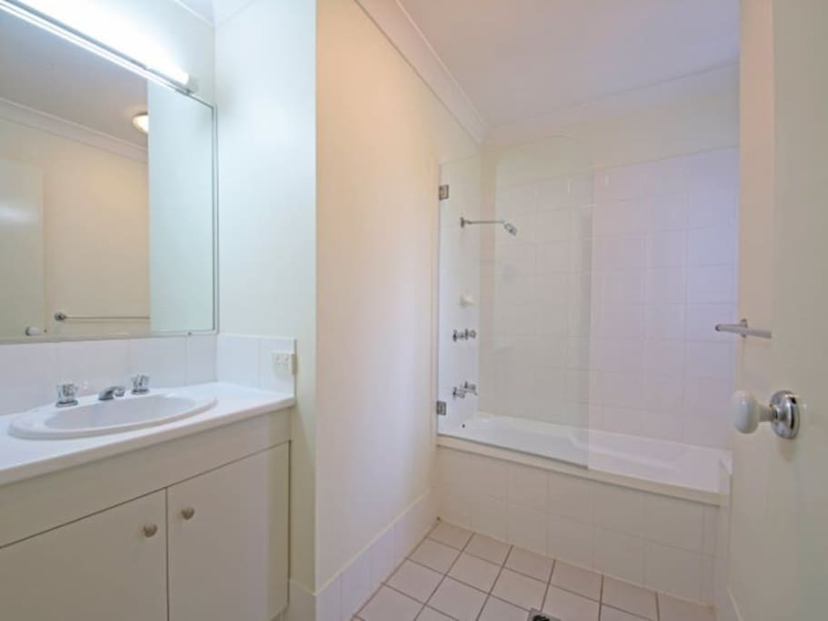 Clean and spacious bath room with tub