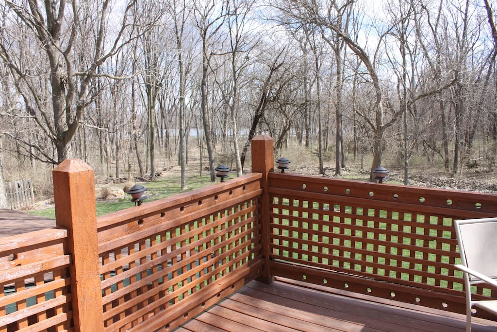 Deck with views of woods and lake - great breakfast spot!!