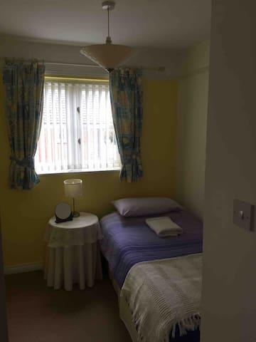 Bedroom three. Single bed and small wardrobe.