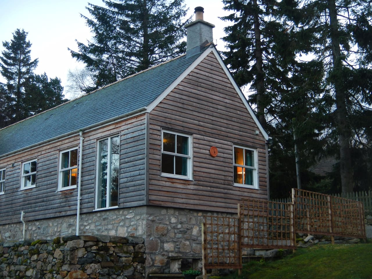 Timber clad cottage located on the edge of the Cairngorm Mountains.