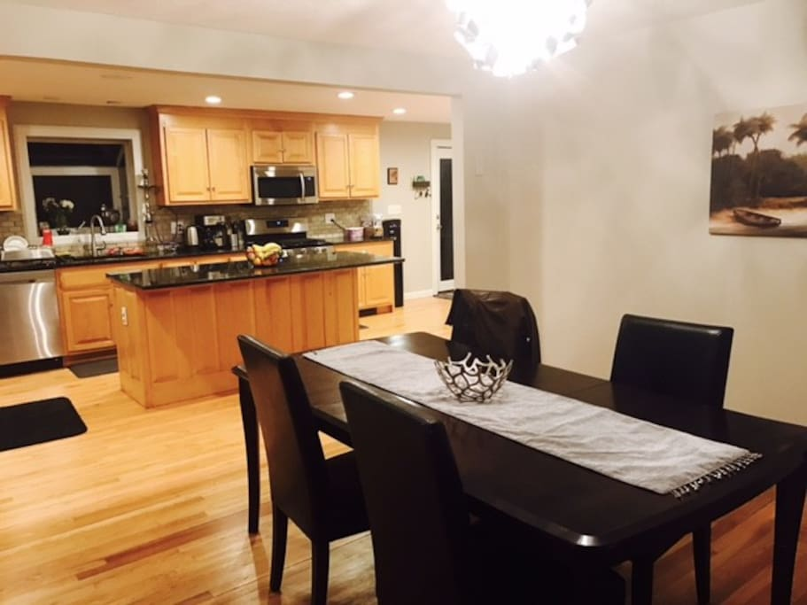 Nice dining area with an open concept on the kitchen for your entertainment.