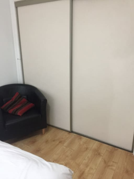 fitted wardrobes, comfy chair.