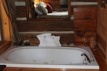 jacuzzi tub with bath robes