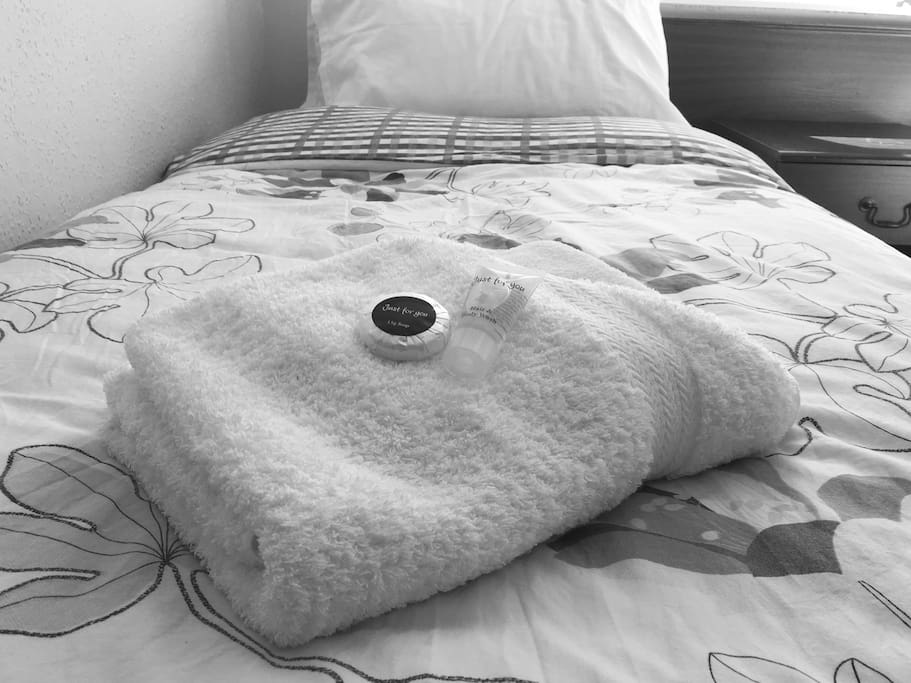 Fresh bedding and towels ready for your stay.