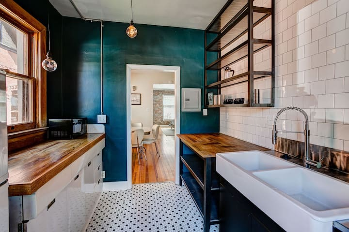 I love this kitchen, the lighting isn't great, but it's super cute. We had this shelving custom made, and I kept the 50's metal cabinetry. The rest is new. I hope you enjoy it, too! The building was built in 1905!