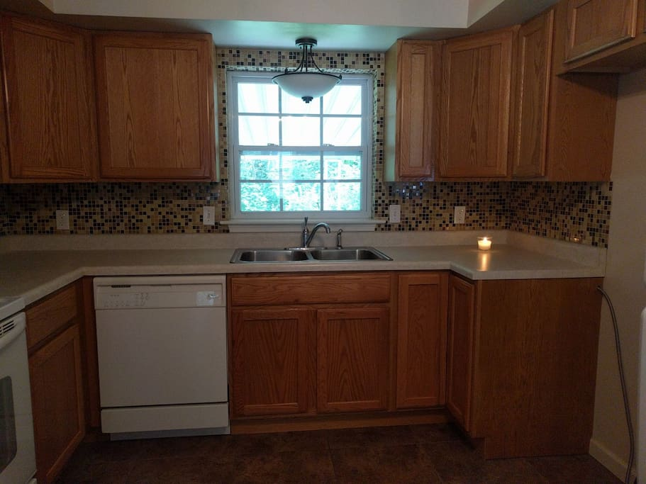 Kitchen , fully equipped with Stove, mircrowave, fridge, dishwasher, pots and pans, utensils, coffee maker, toaster ect.