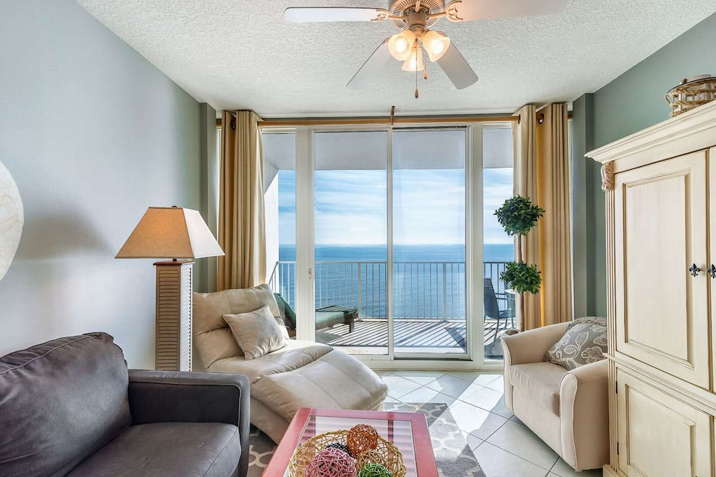 Living room with sliding doors to the balcony overlooking the beach and the Gulf