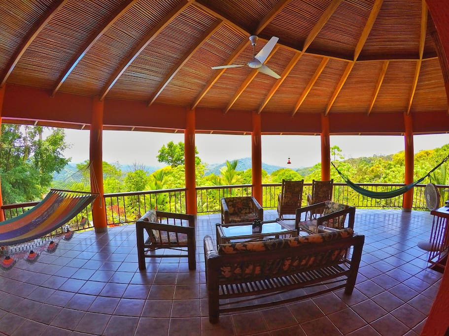 Huge balcony with plenty of seating, 2 large double hammocks, tv and a industrial 60 inch fan to keep you cool.
