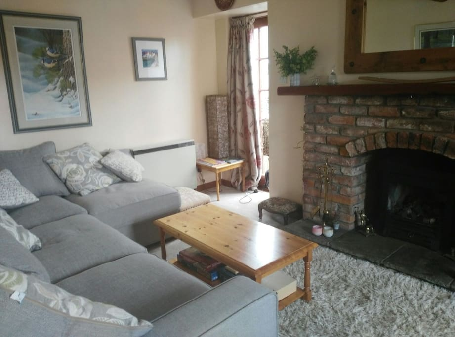 Open gas fire and corner sofa