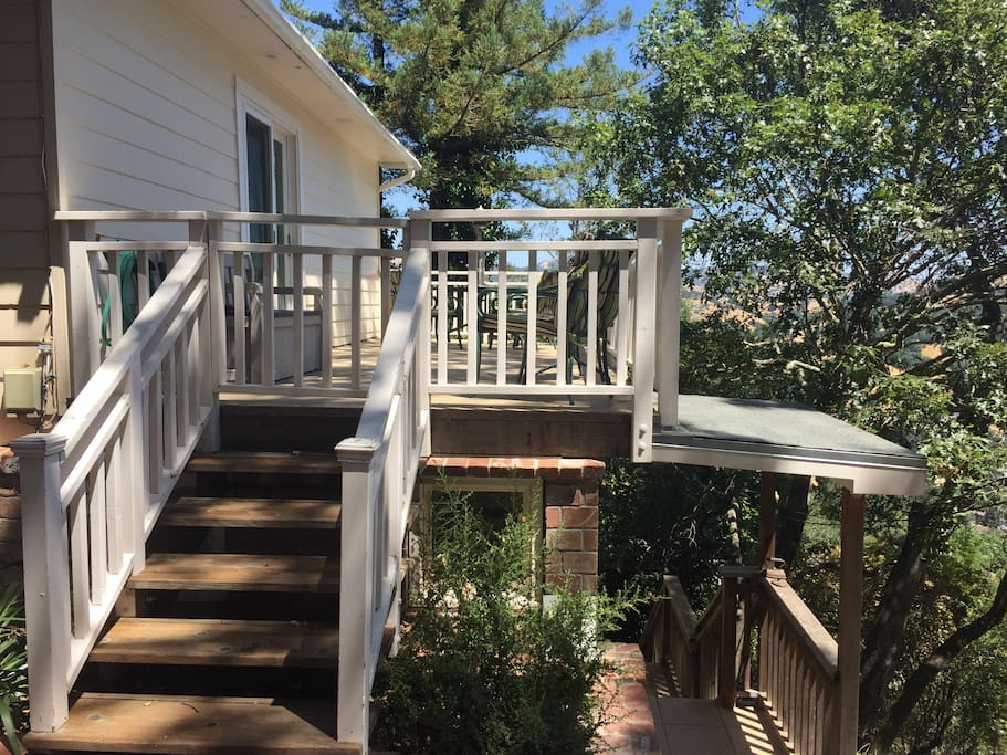 Stairs from deck to brick patio